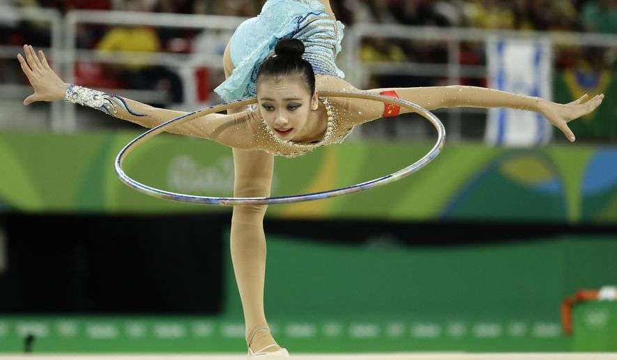 China's Shang Rong performs during the rhythmic gymnastics individual all-around qualifications at the 2016 Summer Olympics in Rio de Janeiro, Brazil, Friday, Aug. 19, 2016. (AP Photo/Dmitri Lovetsky)