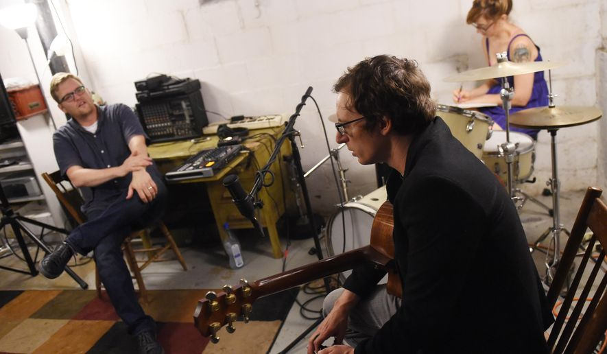 From left, Matt Jones and musician Matt Vial chat in Jones' Ypsilanti, Mich., basement studio as artist Sarah Campbell sketches as they prepare to do a recording for the River Street Anthology on Monday, July 25, 2016. (Melanie Maxwell/The Ann Arbor News via AP)