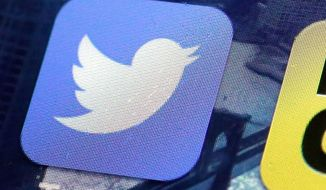 A Twitter app is seen here on an iPhone screen in New York on Oct. 18, 2013. (Associated Press)
