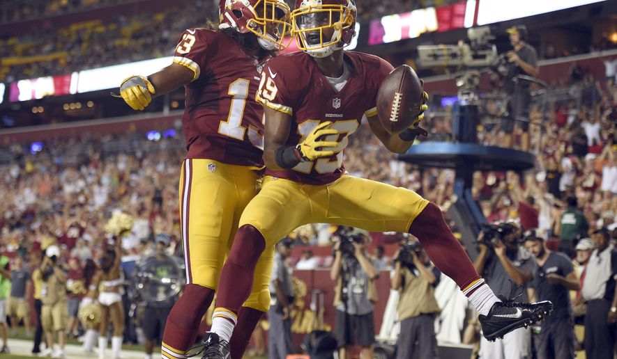 Washington Redskins wide receiver Maurice Harris (13) and wide receiver Rashad Ross (19) celebrate Ross' touchdown during the first half of an NFL preseason football game against the New York Jets, Friday, Aug. 19, 2016, in Landover, Md. (AP Photo/Nick Wass)