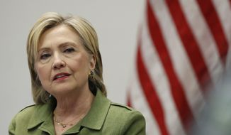 In this photo taken on Aug. 18, 2016, Democratic presidential candidate Hillary Clinton speaks to media as she meets with law enforcement leaders at John Jay College of Criminal Justice in New York. (AP Photo/Carolyn Kaster)