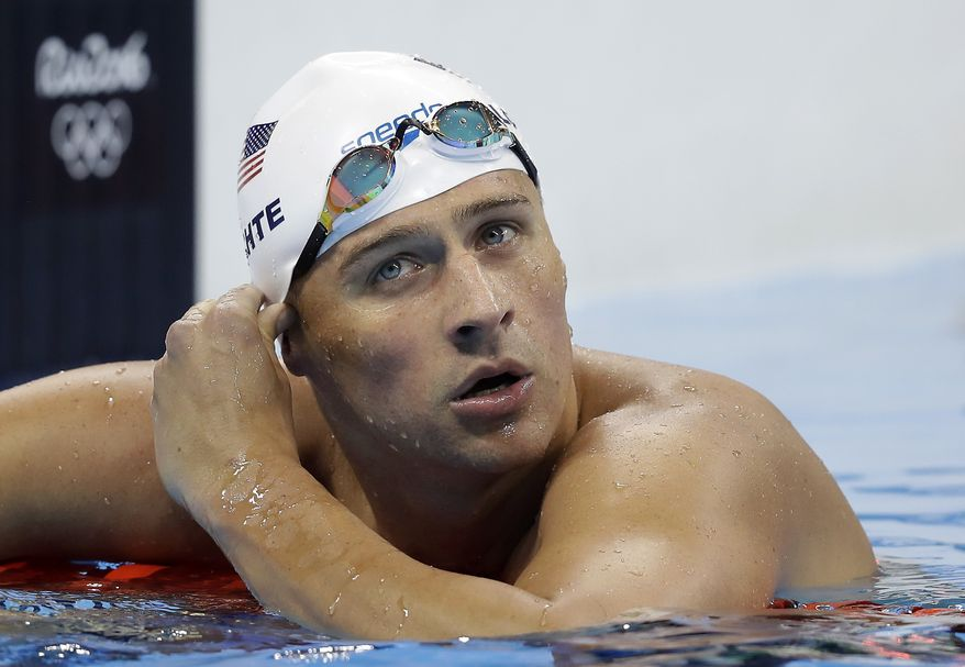 FILE - In this Tuesday, Aug. 9, 2016, file photo, United States' Ryan Lochte checks his time in a men's 4x200-meter freestyle heat during the swimming competitions at the 2016 Summer Olympics, in Rio de Janeiro, Brazil. (AP Photo/Michael Sohn, File) **FILE**