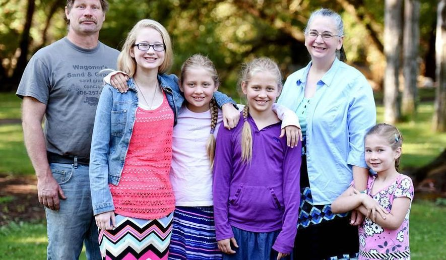 Priscilla and Olivia, 10 year old twin sisters, surrounded by their family on Monday, Aug. 8, at Woodland Park, in Kalispell, Mont. From left, Steve Wagoner, Hadasa, 14, the twins, Nettie Wagoner and Zaria   The Wagoners still found a way to be thankful after a flash fire on a boat sent several of their family members to the hospital to have burns treated. (Brenda Ahearn/The Daily Inter Lake via AP) MANDATORY CREDIT