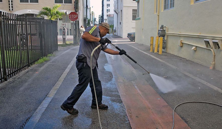 Melvin Gaitan washes down alleyways in Miami Beach, one of the two Florida neighborhoods reporting mosquito-borne Zika cases. High-pressure water set to 250 degrees kills bacteria and mosquito larvae. (Associated Press)