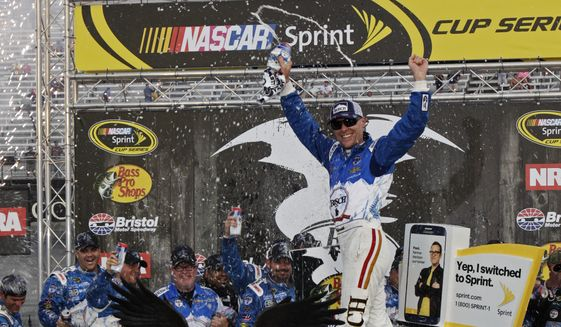 Kevin Harvick celebrates after winning a NASCAR Sprint Cup Series auto race, Sunday, Aug. 21, 2016 in Bristol, Tenn. The race was delayed Saturday night due to severe weather. (AP Photo/Wade Payne)