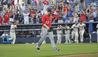 Washington Nationals pitcher Shawn Kelley walks off the field as the walk off home run ball of Atlanta Braves' Jace Peterson sails to the right field wall during the tenth inning of a baseball game, Sunday, Aug. 21, 2016, in Atlanta. Atlanta won 7-6. (AP Photo/John Amis)