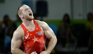 United States' Kyle Frederick Snyder reacts after defeating Georgia's Elizbar Odikadze during the men's 97-kg freestyle wrestling competition at the 2016 Summer Olympics in Rio de Janeiro, Brazil, Sunday, Aug. 21, 2016. (AP Photo/Markus Schreiber)