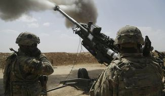 U.S. Army soldiers with 1st Battalion, 320th Field Artillery Regiment, 2nd Brigade Combat Team, 101st Airborne Division (Air Assault), fire an M777 howitzer at Kara Soar Base, Iraq. (Associated Press)