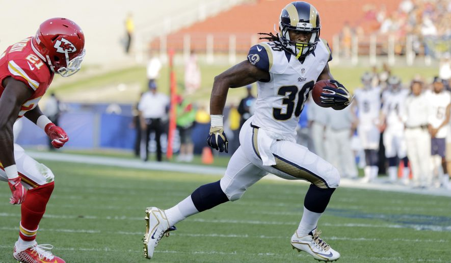 Los Angeles Rams running back Todd Gurley, right, runs the ball while under pressure from Kansas City Chiefs cornerback Eric Murray during the first half of a preseason NFL football game, Saturday, Aug. 20, 2016, in Los Angeles. (AP Photo/Ryan Kang)