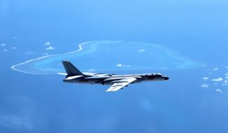 In this undated file photo released by Xinhua News Agency, a Chinese H-6K bomber patrols the islands and reefs in the South China Sea.  (Liu Rui/Xinhua via AP, File) **FILE**