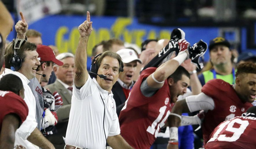 FILE - In this Dec. 31, 2015, file photo, Alabama head coach Nick Saban and team take the field at the end of the Cotton Bowl NCAA college football semifinal playoff game against Michigan State, in Arlington, Texas. Alabama is No. 1 in The Associated Press preseason Top 25 for the third time under coach Nick Saban as the Crimson Tide attempts to win a second straight national title and fifth in eight seasons.  (AP Photo/LM Otero, File)