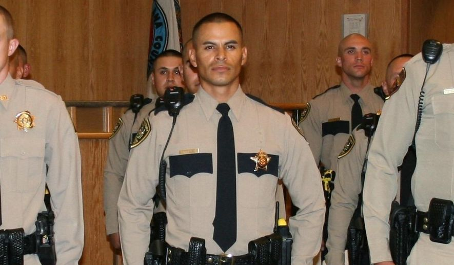 This Oct. 31, 2013, file photo released by Dona Ana County Sheriff shows officer Jose Chavez at his graduation ceremony from our Law Enforcement Academy in Las Cruces, N.M. Hatch Police Officer Chavez, 33, was gunned down during a traffic stop Friday, Aug. 12, 2016. (Dona Ana County Sheriff via AP, File)