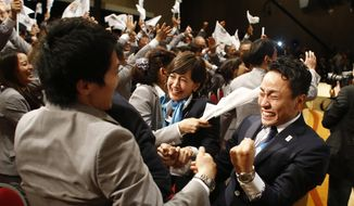 In this Sept. 7, 2013, file photo, members of the Tokyo 2020 delegation celebrate after Tokyo was awarded the 2020 Olympic Games during the 125th IOC session in Buenos Aires, Argentina. The next three Olympics are headed for relatively calmer ports of call in South Korea, Japan and China following the organizational drama surrounding the 2014 Winter Olympics in Russia and the just completed Summer Games in Brazil, but challenges remain, especially when it comes to finances and generating enthusiasm among home audiences. (AP Photo/Victor R. Caivano, File)