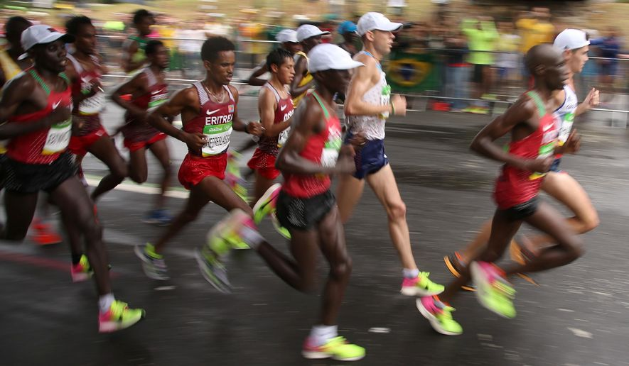 Ghirmay Ghebreslassie, back center, of Eritrea, and Galen Rupp, front center, of the United States, compete during the 2016 Summer Olympics in Rio de Janeiro, Brazil, Sunday, Aug. 21, 2016. (Eric Gaillard/Pool Photo via AP)