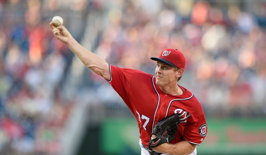 """While he said he can """"gut it through,"""" Washington Nationals pitcher Stephen Strasburg was put on the 15-day disabled list Monday with a sore right elbow. (Associated Press)"""
