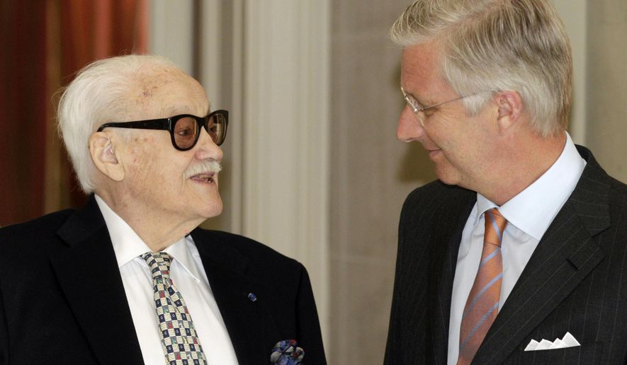 FILE - In this May 6, 2014 file photo, Belgium's King Philippe speaks with Belgian jazz musician and harmonica player Toots Thielemans, left, at the Royal Palace in Laeken near Brussels.  Belgian media reported on Monday, Aug. 22, 2016, that legendary jazz harmonica player Toots Thielemans has died at the age of 94. (AP Photo/Yves Logghe, File)