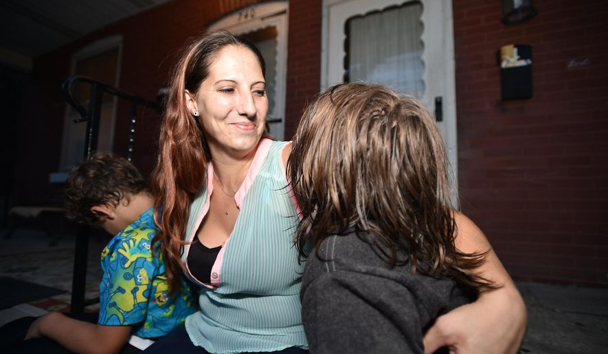 Tracey Maholland spends time with her children on Aug. 10, 2016 in Bethlehem, Pa  Maholland is a recovering drug addict who abused both heroin and methamphetamine, even as her three daughters and two sons looked to her to guide them through the pitfalls of childhood. Struggles like hers are common as Pennsylvania grapples with a heroin epidemic fueled by cheap access to the drug and the overprescription of painkillers. (April Bartholomew/The Morning Call via AP)
