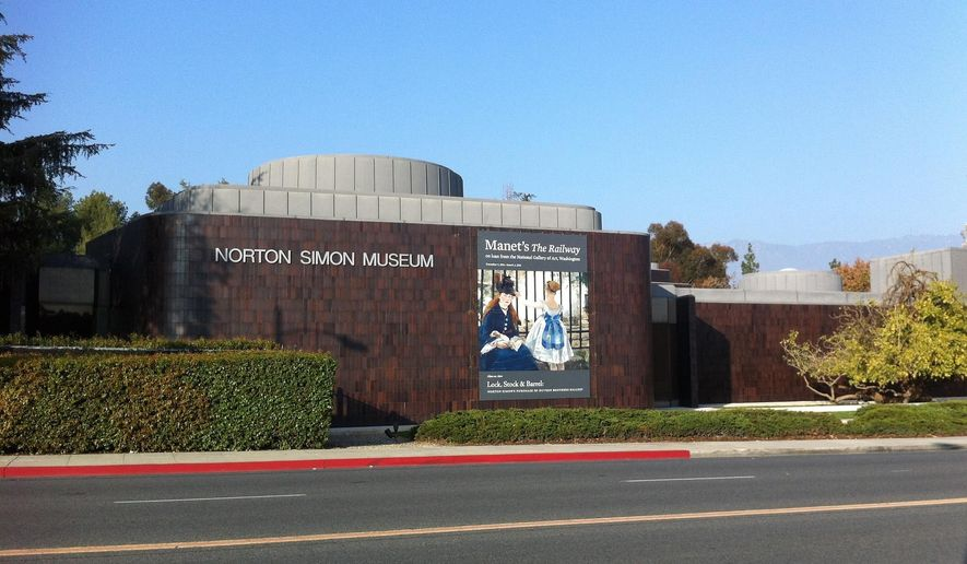 """FILE - This Jan. 21, 2015, file photo shows the exterior of the Norton Simon Museum in Pasadena, Calif. A woman who has been fighting for almost a decade over ownership of two German Renaissance masterpieces depicting """"Adam"""" and """"Eve"""" seized by the Nazis during World War II, has lost after a judge ruled in favor of the Southern California museum where they have hung for more than 30 years. U.S. District Court Judge John F. Walter ruled that the Norton Simon Museum is the rightful owner of the two life-size oil-on-panel paintings in a decision that the museum describes as mindful of """"the facts and law at the heart of the dispute."""" (AP Photo/John Antczak, File)"""