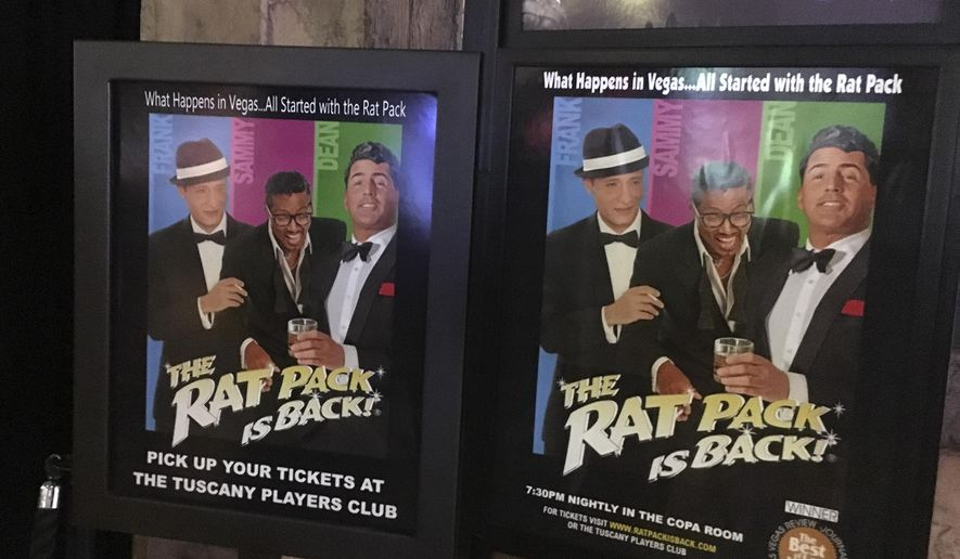 In this Aug. 12, 2016 photo, posters advertising an upcoming Rat Pack tribute show is shown at the Tuscany Suites and Casino in Las Vegas. Although Frank Sinatra's presence in Sin City has faded, fans can still locate pieces of his Las Vegas legacy with a little homework and a desire to look beyond popular, contemporary tourist attractions. (AP Photo/Russell Contreras)