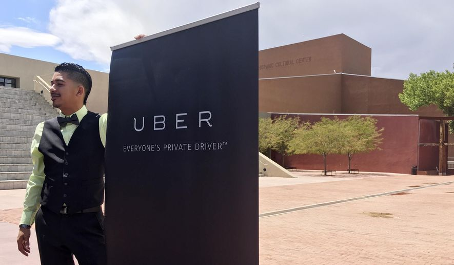 Isaac Sanchez, 28, a driver for ride-hailing company Uber, prepares to speak at a press conference Monday, Aug. 22, 2016. (AP Photo/Russell Contreras)