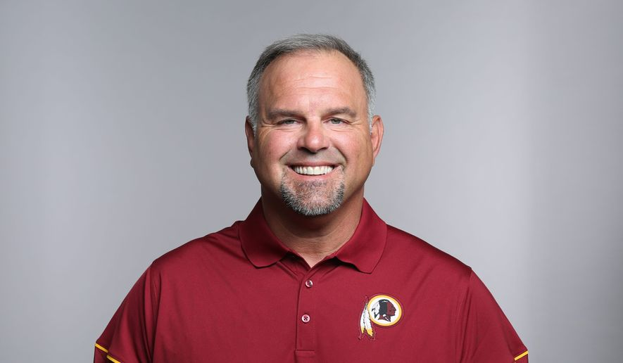 """First-year Washington Redskins outside linebackers coach Greg Manusky said """"the way you coach your players is the way they're going to act and how they're going to perform."""" (Associated Press)"""