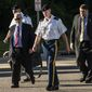 Sgt. Bowe Bergdahl, second from left, and some of his attorneys arrive the courthouse Monday, Aug 22, 2016, at Fort Bragg, N.C. Attorneys for Bergdahl are scheduled to argue Tuesday that decision-makers with power over the soldier's prosecution were improperly swayed by negative comments from U.S. Sen. John McCain. (Raul R. Rubiera/The Fayetteville Observer via AP)