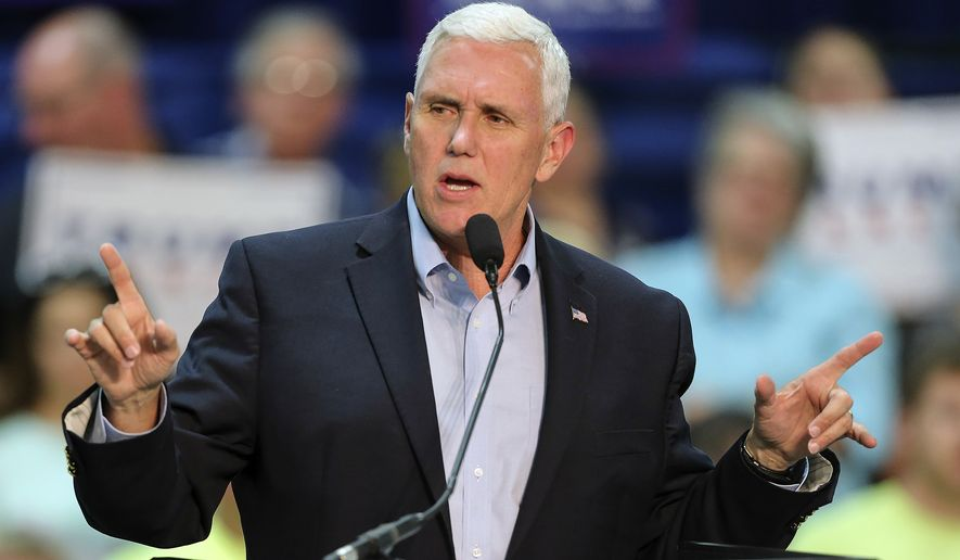 """The fact that you see Democrats and Hillary Clinton and her running mate rolling out the same old playbook of racial divisiveness sounds a little bit to me like an act of desperation,"" Mike Pence said. (Associated Press)"