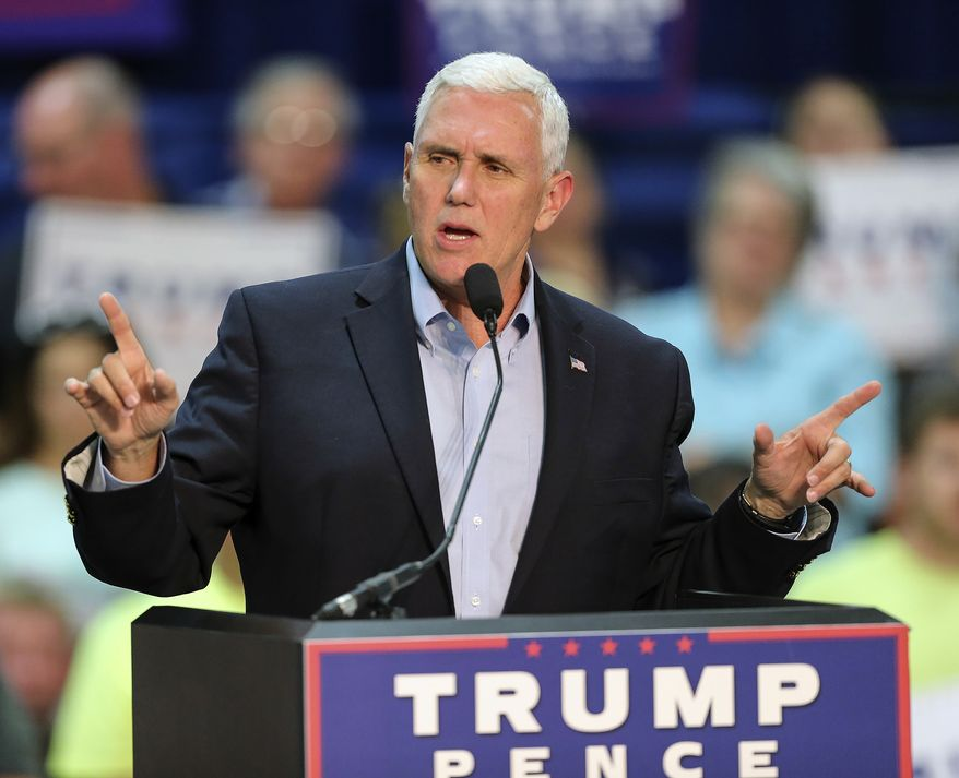 """""""The fact that you see Democrats and Hillary Clinton and her running mate rolling out the same old playbook of racial divisiveness sounds a little bit to me like an act of desperation,"""" Mike Pence said. (Associated Press)"""