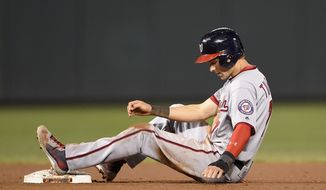 Washington Nationals' Trea Turner sits in the dirt after he was out at second after Jayson Werth grounded into a double-play during the seventh inning of a baseball game against the Baltimore Orioles, Tuesday, Aug. 23, 2016, in Baltimore. The Orioles won 8-1. (AP Photo/Nick Wass)