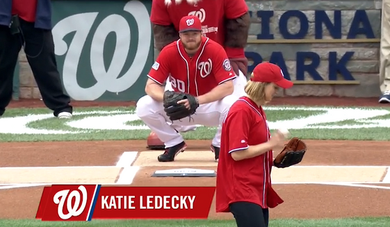 Katie Ledecky preparing to toss out the ceremonial first pitch at Game One of the NLDS in Nationals Park in 2014. The Bethesda, Md., native will throw out the first pitch at the Orioles-Nationals game in Nats Park on Wednesday, August 24, 2016. Image via MLB.com video screen grab.