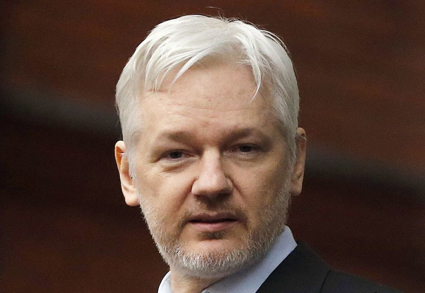 WikiLeaks founder Julian Assange stands on the balcony of the Ecuadorean Embassy in London, Feb. 5, 2016. (AP Photo/Frank Augstein, File)