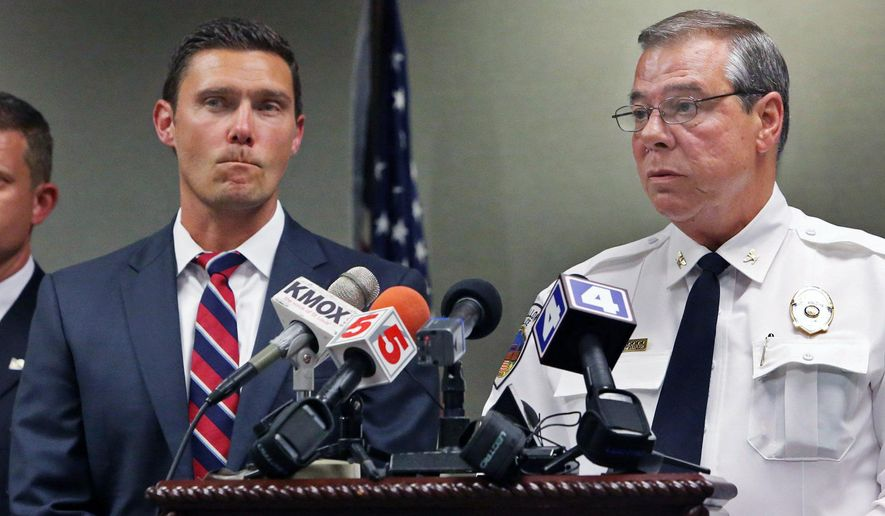 Tim Lohmar, left, prosecuting attorney for St. Charles County, and O'Fallon Police Chief Roy Joachimstaler speak during a news conference, Tuesday, Aug. 23, 2016 in O'Fallon, Mo. Pamela Hupp of O'Fallon, Missouri, was arrested Tuesday and charged with first-degree murder. Police say she is hospitalized in stable condition after repeatedly stabbing herself with a pen in a women's restroom while in custody. Bond is set at $2 million. Hupp fatally shot Louis Gumpenberger Aug. 16. (J.B. Forbes/St. Louis Post-Dispatch via AP)