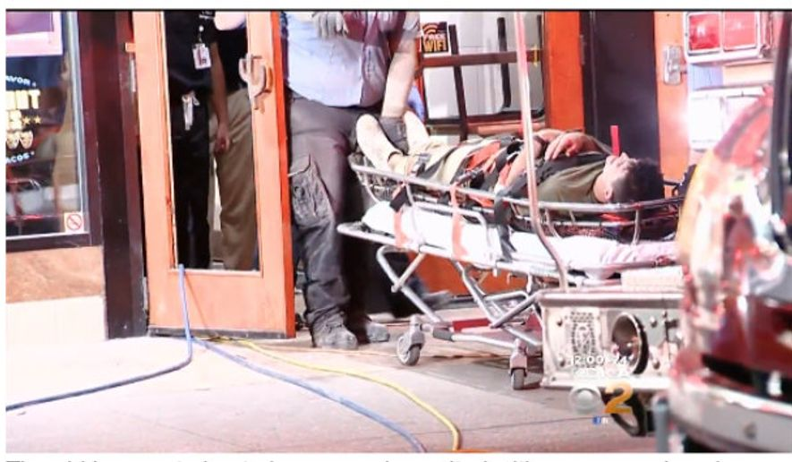 Grant Birdsong, 22, is wheeled away in a stretcher in this screen capture of an August 23 report by KDKA-TV in Pittsburgh. Mr. Birdsong, 22, was stuck for more than four hours between two buildings. He had attempted to jump from one to the other in order to impress a young woman, said witnesses.