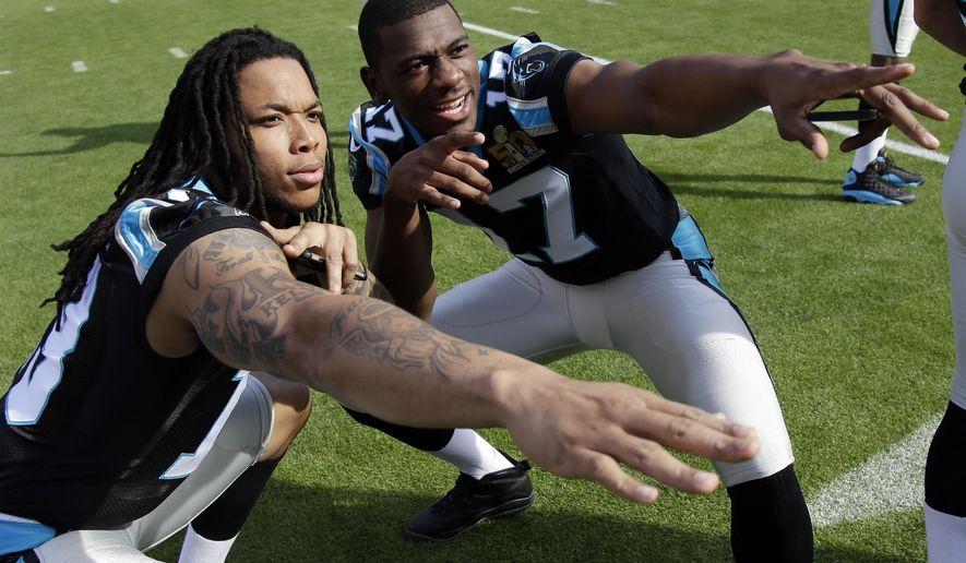 FILE - In this Feb. 6, 2016, file photo, Carolina Panthers wide receivers Kelvin Benjamin, left, and Devin Funchess (17) pose for a photo inside Levi's Stadium as they gathered for a team photo in preparation for the Super Bowl 50 football game, in Santa Clara, Calif. After a solid rookie season, Funchess appears ready to take on the role of starting wide receiver opposite Benjamin.(AP Photo/Marcio Jose Sanchez, File)
