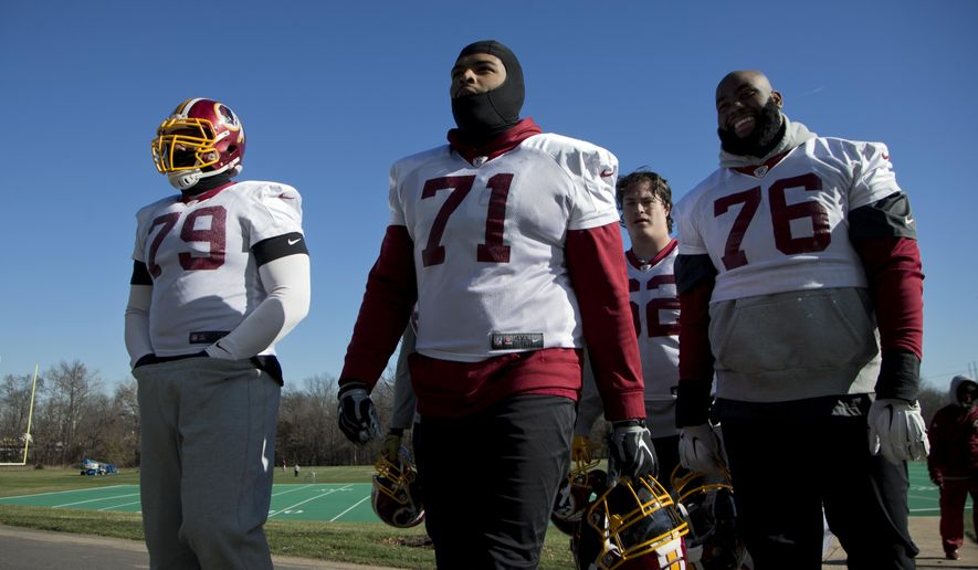 FILE - In this Jan. 6, 2016, file photo, Washington Redskins offensive tackle Trent Williams (71) leaves the field with teammates Ty Nsekhe (79), Morgan Moses (76), and Austin Reiter (62), at the end of a team practice at Redskins Park in Ashburn, Va. Williams gathered his fellow Redskins offensive linemen at his house in Houston during the offseason to bond and work out. His goal was to form Hogs 2.0, a nod to the legendary Super Bowl-winning Redskins line. (AP Photo/Manuel Balce Ceneta, File)