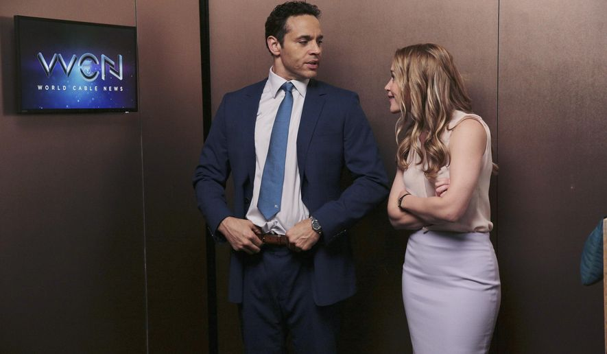 """This image released by ABC shows Daniel Sunjata, left, and Piper Perabo in a scene from """"Notorious,"""" premiering on Sept. 22. (Eli Joshua Ade/ABC via AP)"""