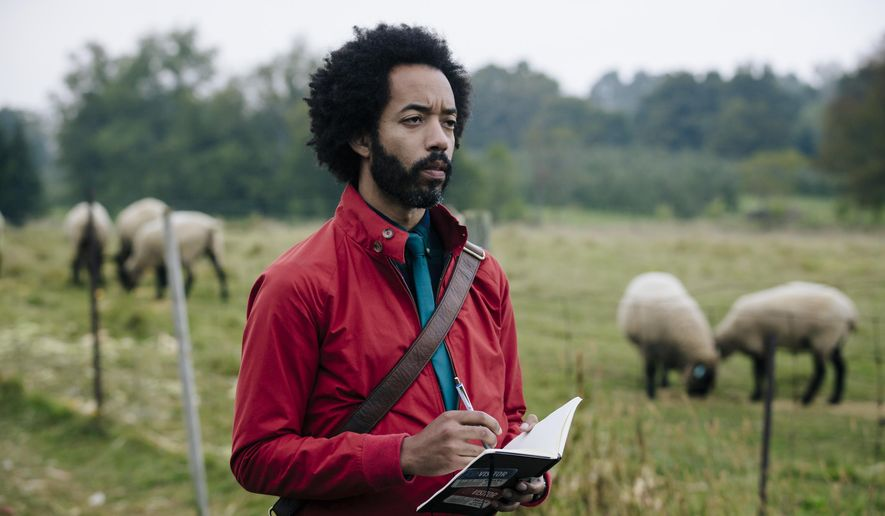 "This image released by TBS shows Wyatt Cenac in a scene from ""People of Earth,"" premiering on Oct. 31. (Jan Thijs/TBS via AP)"