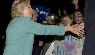 Democratic presidential nominee Hillary Clinton greets people outside on the street as she leaves a fundraiser in Piedmont, Calif., Tuesday, Aug. 23, 2016. (AP Photo/Carolyn Kaster)