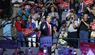 Republican presidential candidate Donald Trump arrives to speak at a campaign rally in Jackson, Miss., Wednesday, Aug. 24, 2016. (AP Photo/Gerald Herbert)