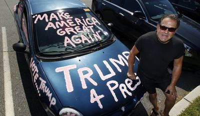 Guido Tardive, of Mine Hill, N.J., a supporter of Republican Donald Trump for President, stands with his painted car Wednesday, Aug. 24, 2016, in Randolph, N.J. (AP Photo/Mel Evans) ** FILE **