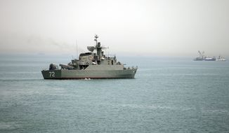 Iranian warship Alborz prepares to leave Iran's waters at the Strait of Hormuz on April 7, 2015. (Associated Press)