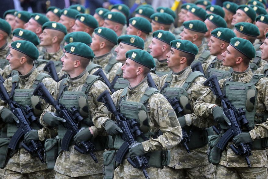 Ukrainian soldiers march down Kiev's main street during military parade to mark the 25th anniversary of Ukraine's Independence, in the capital Kiev, Ukraine, Wednesday, Aug. 24, 2016. (AP Photo/Efrem Lukatsky)