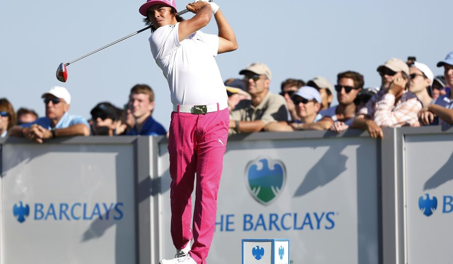 IFLE - In this Aug. 23, 2013, file photo, Rickie Fowler hits a tee shot on the 17th hole during the third round of The Barclays golf tournament in Jersey City, N.J. So much more is at stake than $69 million in prize and bonus money during the FedEx Cup. The Barclays is the first postseason event, the start of deciding Ryder Cup teams and who gets voted player of the year. (AP Photo/John Minchillo, File)