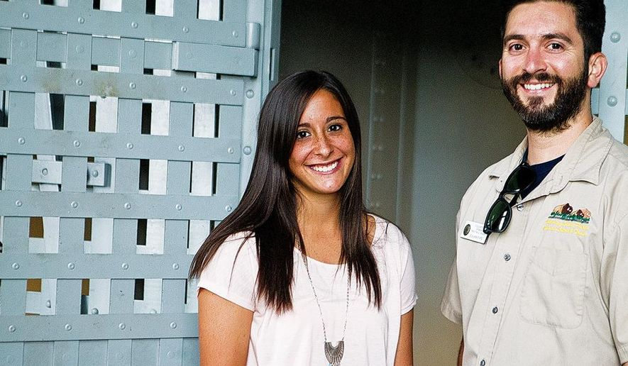 ADVANCE FOR THE WEEKEND OF AUG. 27-28 AND THEREAFTER - Lizzie Cardenas, left, and Curtis Leon, seen in an Aug. 3, 2016 photo, are both summer interns at the Wyoming Territorial Prison State Historic Site in Laramie, Wy. A handful of college students are getting firsthand history lessons at the Wyoming Territorial Prison State Historic Site, which launched a student internship program in the spring.  (Shannon Broderick/Laramie Boomerang via AP)