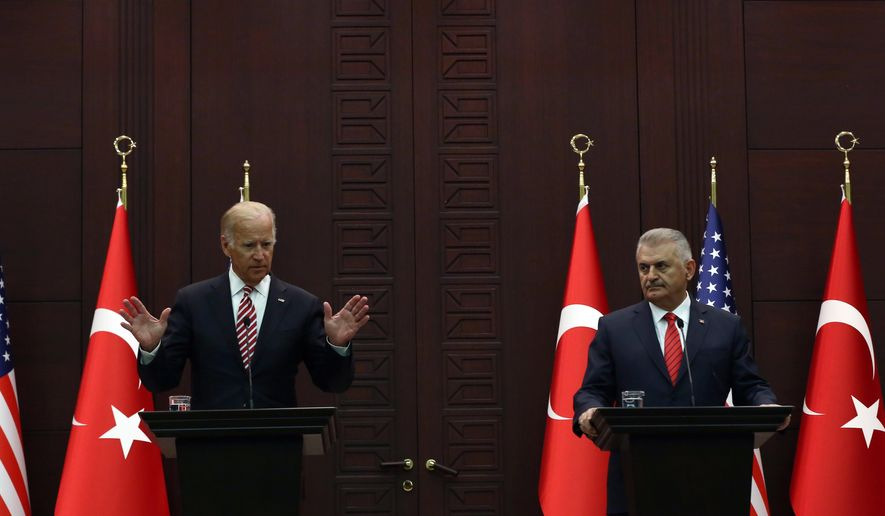 U.S Vice President Joe Biden, left, speaks to the media after talks with Turkish Prime Minister Binali Yildirim in Ankara, Turkey, Wednesday, Aug. 24, 2016. Biden called on Turkish authorities on Wednesday to be patient with the U.S. legal system as Turkey seeks the return of a cleric accused of masterminding last month's failed military coup. Biden, who met with Turkish officials in Ankara, said that the extradition process would take time as he reaffirmed Washington's cooperation in the case of U.S.-based Muslim cleric Fethullah Gulen. (AP Photo/Burhan Ozbilici)