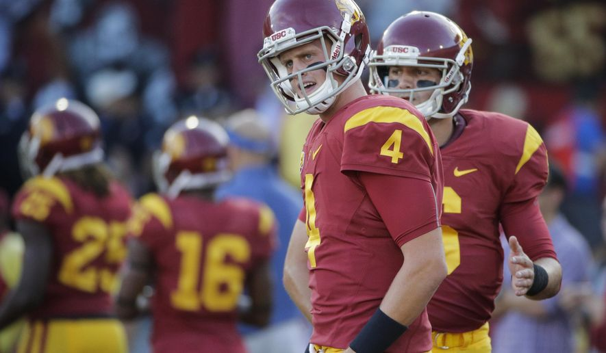FILE - In this Oct. 8, 2015, file photo, Southern California quarterback Max Browne warms up before the team's NCAA college football game against Washington  in Los Angeles. After backing up Cody Kessler for the last two seasons, the redshirt junior Browne will make his first career start for the No. 20 Trojans against defending champion and top-ranked Alabama in Arlington, Texas, on Sept. 3. (AP Photo/Jae C. Hong, File)