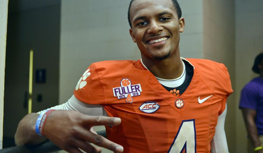 """FILE - In this Nov. 7, 2015, file photo, Clemson quarterback Deshaun Watson poses for a photo after their 23-17 win over Florida State in an NCAA college football game, in Clemson, S.C. Watson says he's ready for the onslaught and plans to handle the glare in his """"roll with it"""" style that's worked so well throughout his life.  (AP Photo/Richard Shiro, File)"""