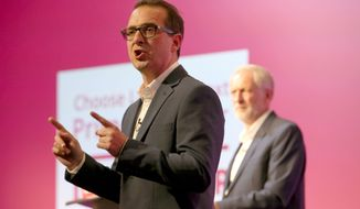 Leadership contender for Britain's Labour Party, with Owen Smith, left, and Jeremy Corbyn, during a debate in front of an audience of party members at the Scottish Exhibition and Conference Centre in Glasgow, Thursday Aug. 25, 2016. Corbyn faces a leadership challenge from Owen Smith, which will conclude at the upcoming Leadership Conference on Sept. 24. (Jane Barlow / PA via AP)