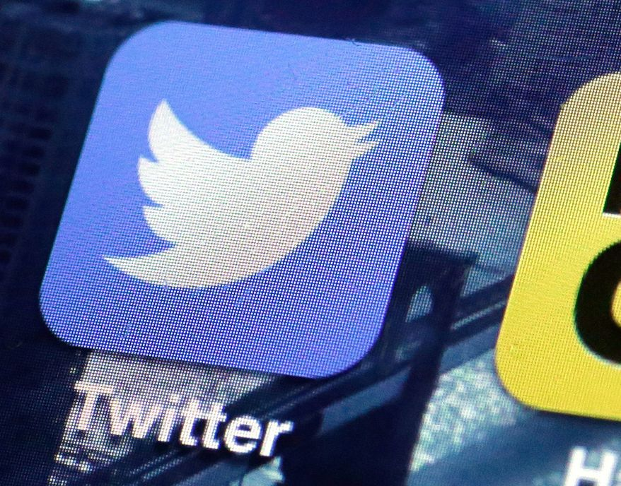 This Friday, Oct. 18, 2013, file photo, shows a Twitter app on an iPhone screen in New York. (AP Photo/Richard Drew, File) *FILE*