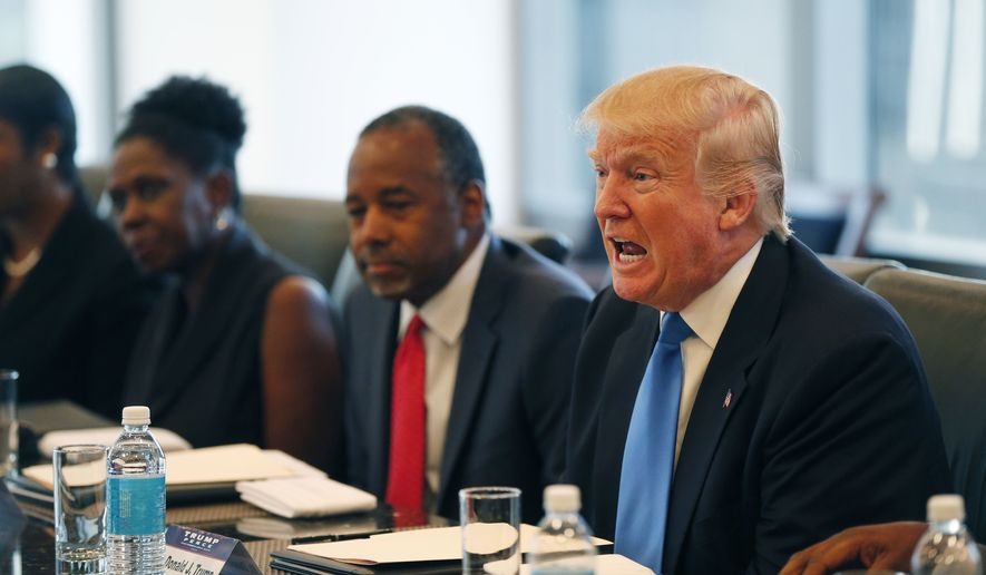 Republican presidential candidate Donald Trump, seated next to Dr. Ben Carson, holds a roundtable meeting with the Republican Leadership Initiative in his offices at Trump Tower in New York, Thursday, Aug. 25, 2016. (AP Photo/Gerald Herbert)